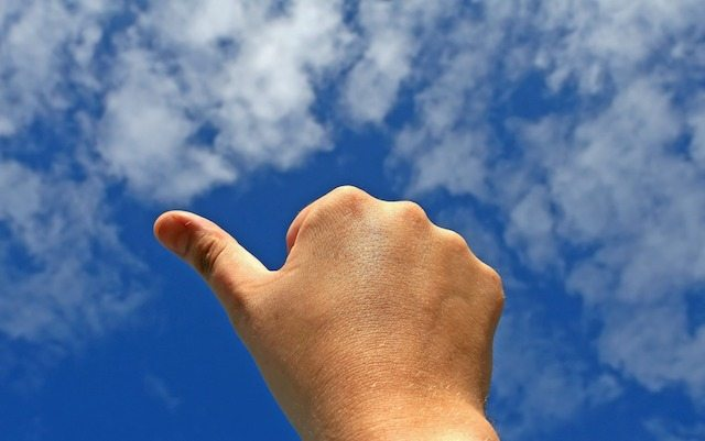 public vs private cloud, thumbs up in cloud sky image