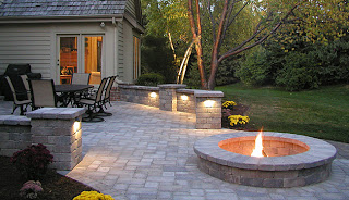 patio with firepit and lighting features