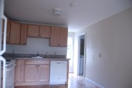 View of kitchen looking towards bathrooms