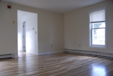 Spacious Living room with new hardwood floors!