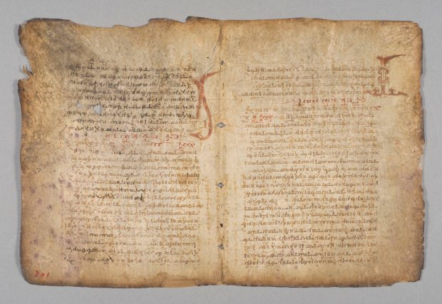 "In this undated image provided by the Walters Art Museum, a page from the Archimedes Palimpsest is seen on display. Without the aid of ultraviolet light, a spiral written on the top center of the page is nearly invisible. Ancient mathematical genius Archimedes' text will be on display in the Baltimore museum's exhibition ""Lost and Found: The Secrets of Archimedes"" before it is returned to its anonymous owner. (AP Photo/The Walters Art Museum)"