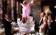 women jumping from cakes