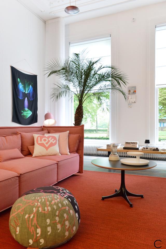 Vitra Design Kwartier Den Haag Studio van t Wout livingroom sofa sidetable design red pink