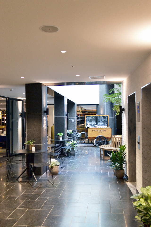 Patio and entry with black wire chair and black table by HAY   Ink Hotel Amsterdam   Tried + Tested   Design Hotel   Boutique Hotel   Picture © By C-More