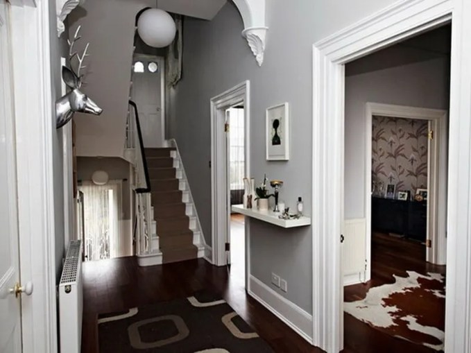 Brown and grey wouldn't have sprung to mind as a colour combination, until now. Dark wood floors, soft grey walls and the contrasting brown rugs and stair runner are a sophisticated combination.