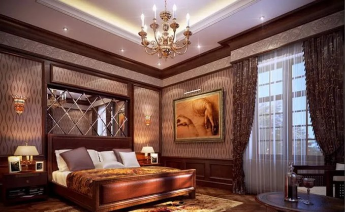 The symmetric mirror above the headboard served as focal point creates depth to this classic bedroom design.