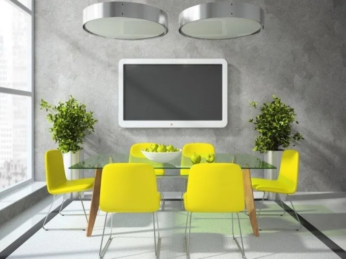 Grey-dining-room-with-TV-and-yellow-chairs