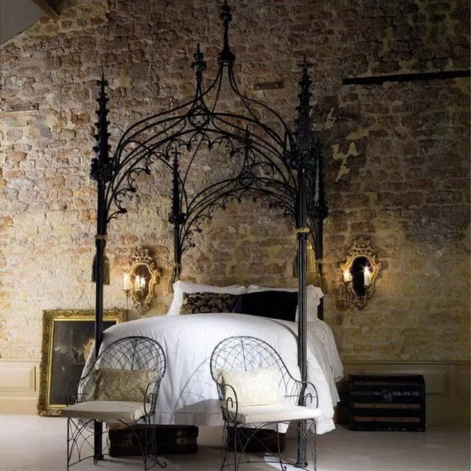a-single-canopy-bed-look-dramatic-when-placed-on-the-front-of-exposed-brick-walls-flanked-by-two-classic-mirrors-and-two-chandles
