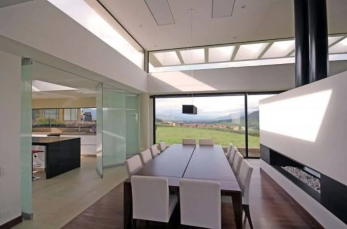 Sleek Dining Room with Fireplace