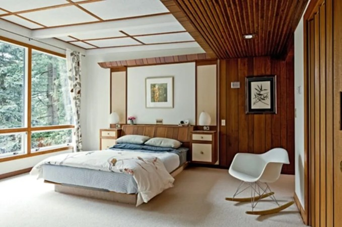 Airy Bedroom with Wood Paneling