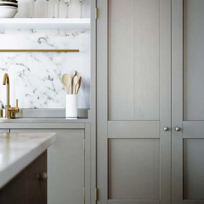 Sleek Kitchen with Brass Faucet