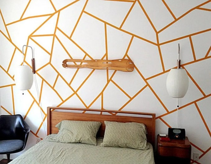 Contemporary Bedroom with geometric wallpaper