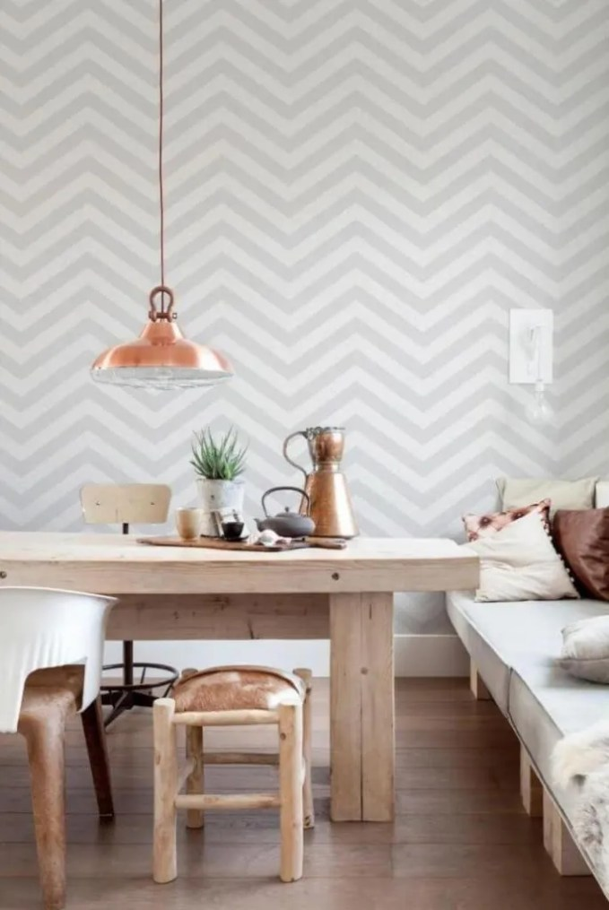 Rustic Dining Room with Geometric Wallpaper