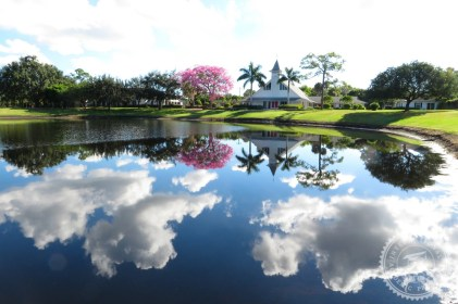 A breathtaking reflection of the clouds in a clear lake on a campus in Miami, Florida