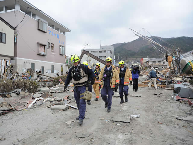 an image showing a rescue team following the 2011 tsunami in Japan