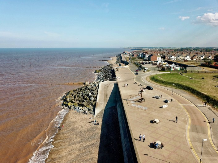 Rock armour and groynes at Withernsea - view south