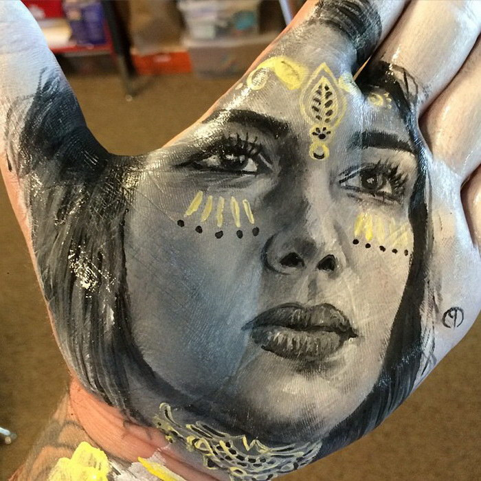 Russell Powell takes social media by storm creating portraits on the palms of his hand