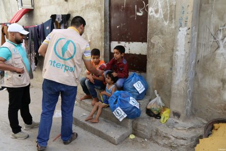 Interpal staff distribute aid to Palestinian refugee children