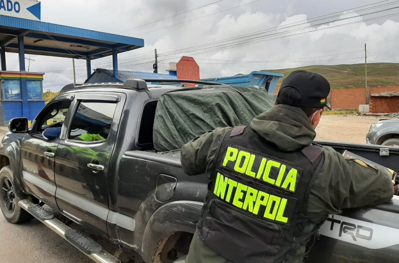 As part of Operation Trigger VI, a Bolivian police officer searches a vehicle at a suspected firearms trafficking hotspot