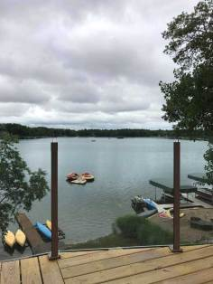 custom glass railing overlooking lake