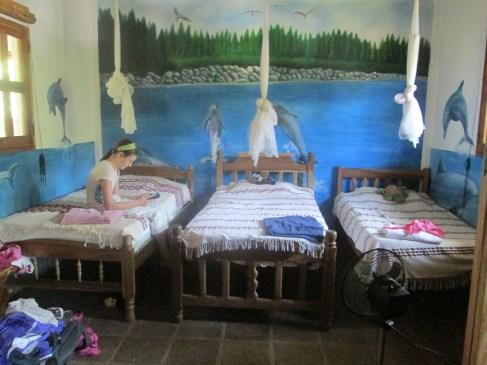 The kids' side of  our family room is painted with beautiful murals