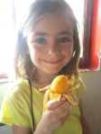 Lanie enjoys a mango before we embark.