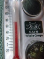 Zoe's LL Bean thermometer, compass, magnifying glass zipper pull is being a little generous here.  It was in the low 60s when we started our trip.