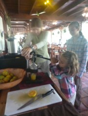Squeezing oranges at a lodge breakfast