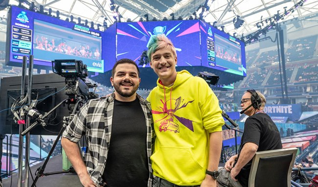 """YouTube personality Jack """"CouRage"""" Dunlop and gamer Richard Blevins (better known as Ninja) at the Fortnite World Cup in July 2019. Right: The IBM 286 desktop personal computer."""