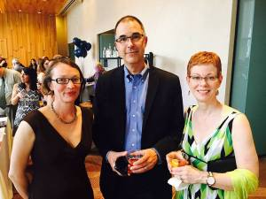 Flanked at the reception by KPLU's Ashley Gross and first reader Dee Dee Catalano.