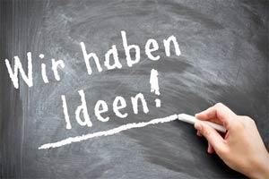 Mit Kreide geschriebener Schriftzug: Wir haben Ideen!