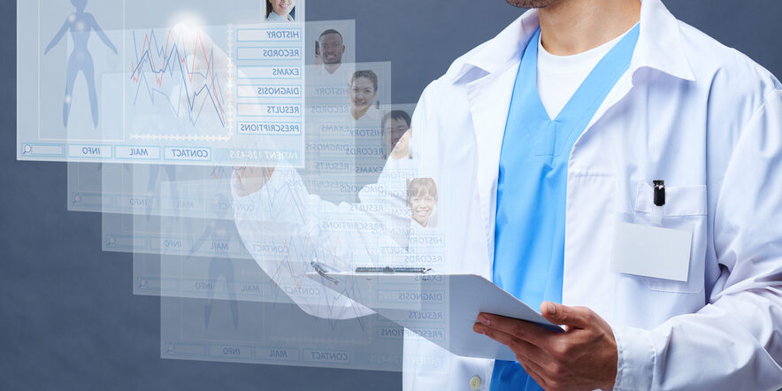 Doctor looking through medical record cards of patients