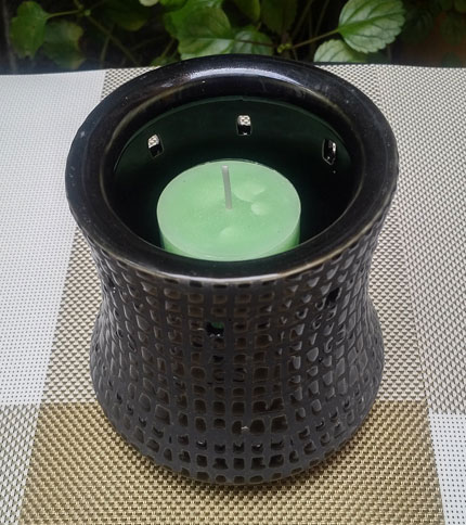 Foto 4. Candelabro de ceramica con vela. Negro