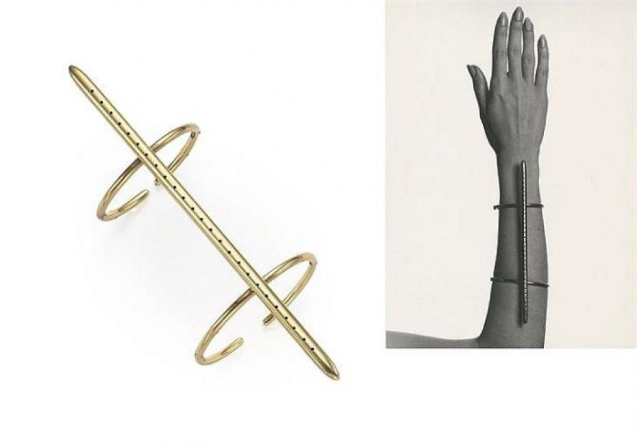 Striking gold bracelet with a dynamic linear design that spans the length of its wearer's forearm