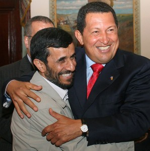 Iran's President Ahmadinejad is welcomed by Venezuela's President Chavez in Caracas