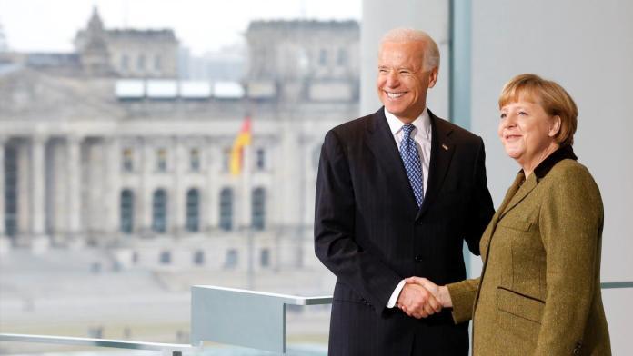Reuters RTR3D87Z Merkel Biden