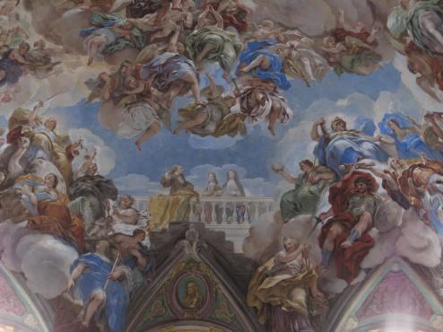 Luca Giordano: Detalle de Carlos II, Mariana de Neoburgo y Mariana de Austria, en la bóveda de la Escalera. Monasterio de San Lorenzo de El Escorial, Madrid.