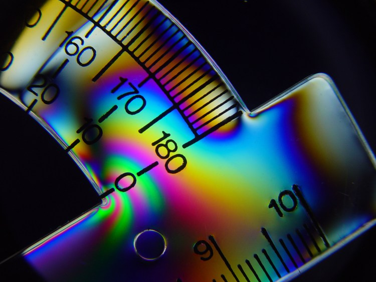Tension lines in plastic protractor seen under cross polarized light - Market timing