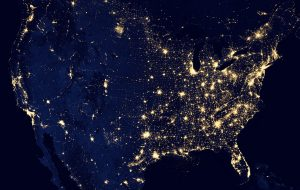 "NASA image acquired offshore April 18 - October 23, 2012 This image of the United States of America at night is a composite assembled from data acquired by the Suomi NPP satellite in April and October 2012. The image was made possible by the new satellite's ""day-night band"" of the Visible Infrared Imaging Radiometer Suite (VIIRS), which detects light in a range of wavelengths from green to near-infrared and uses filtering techniques to observe dim signals such as city lights, gas flares, auroras, wildfires, and reflected moonlight. Instrument: Suomi NPP - VIIRS Projection: Albers equal-area conic, WGS84 datum, standard parallels 29.5°N and 44.5°N, central meridian 96°W, origin latitude 23°N"