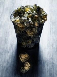 Wastebasket Filled with Crumpled 00 Dollar Bills