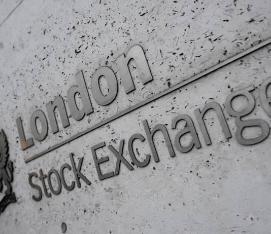 FTSE 100 hits new record high
