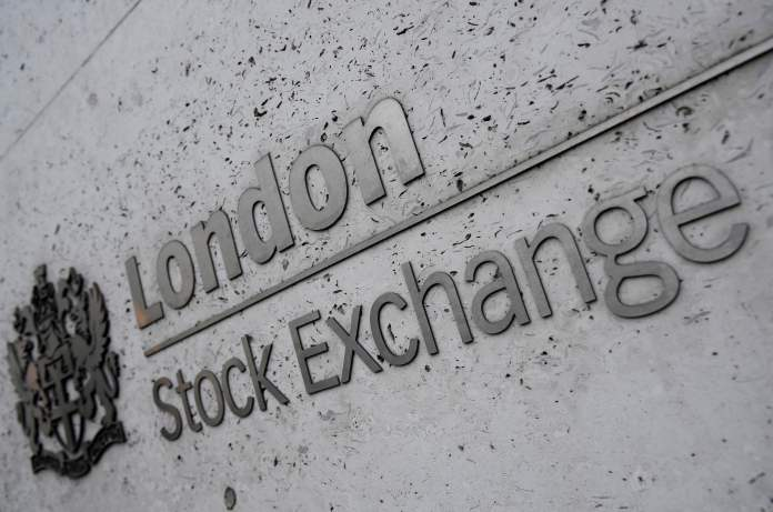 FTSE 100 hits new record high