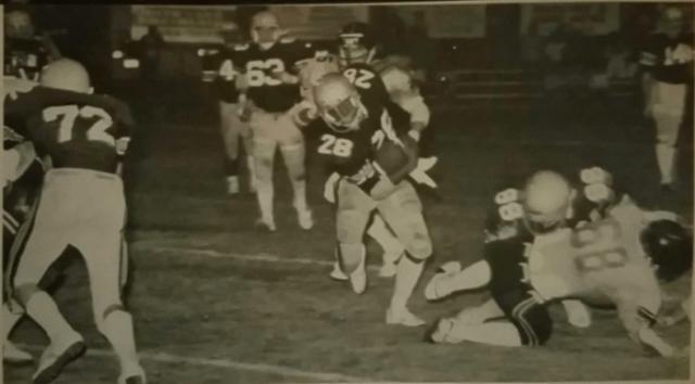 Football play runner avoiding Defense