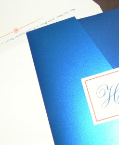 Blue Wedding Invitations | shiny metallic blue pocket card, coral orange flowers, monogram | Blue and Orange Pocket Wedding Invitations | wedding colors