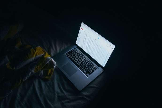 Glare from laptop in a dark room.