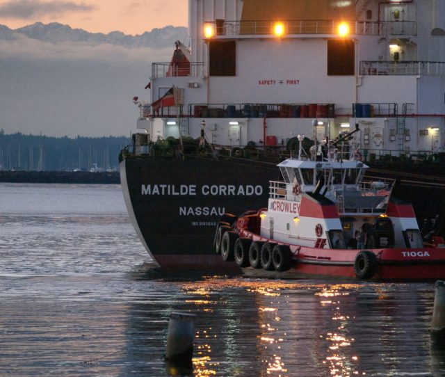 A Tug Boat And Cargo Ship Leave Elliot Bay In Seattle  Photo Credit Flickr Ingrid Taylar