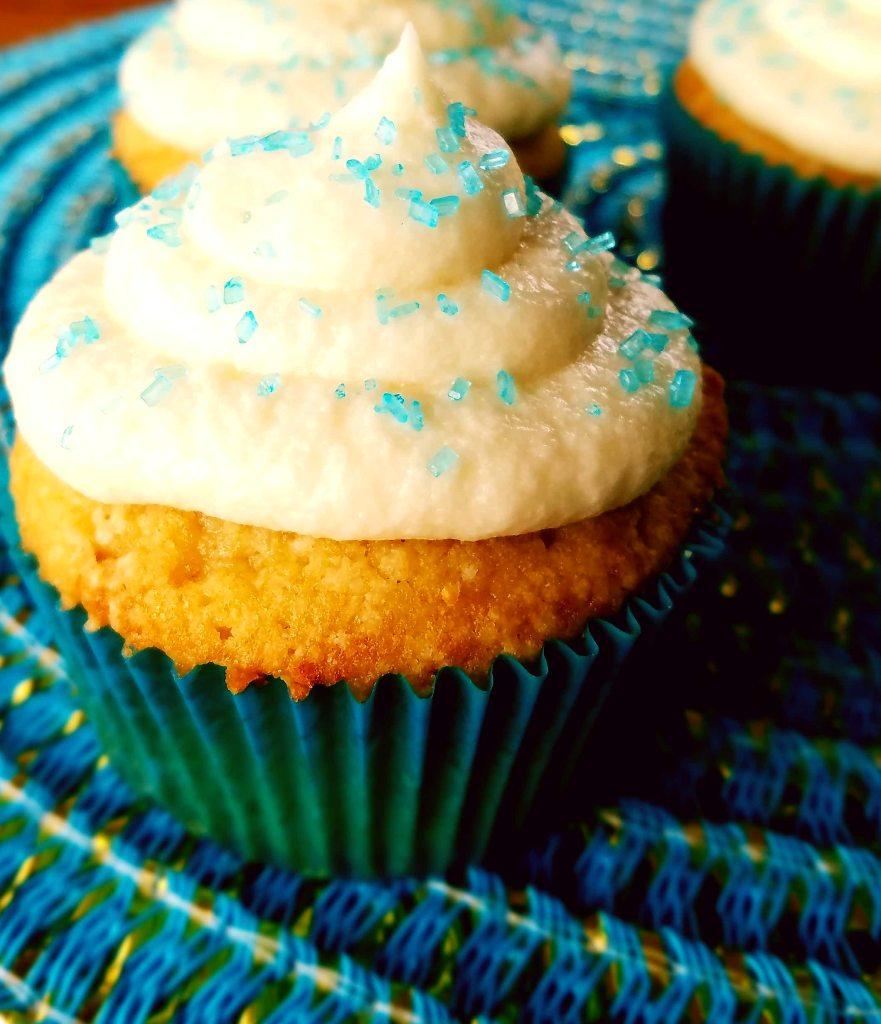 Classic vanilla cupcakes that are made from scratch and topped with a simple and easy homemade buttercream frosting.