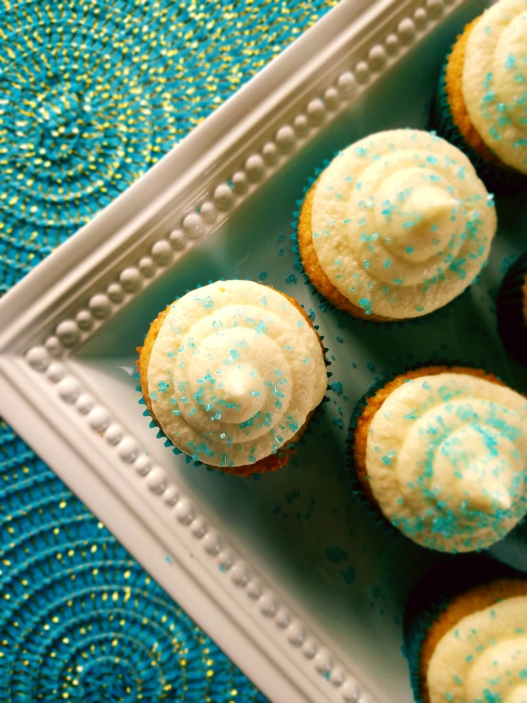 Classic vanilla cupcakes with a simple and easy vanilla frosting sure to impress.