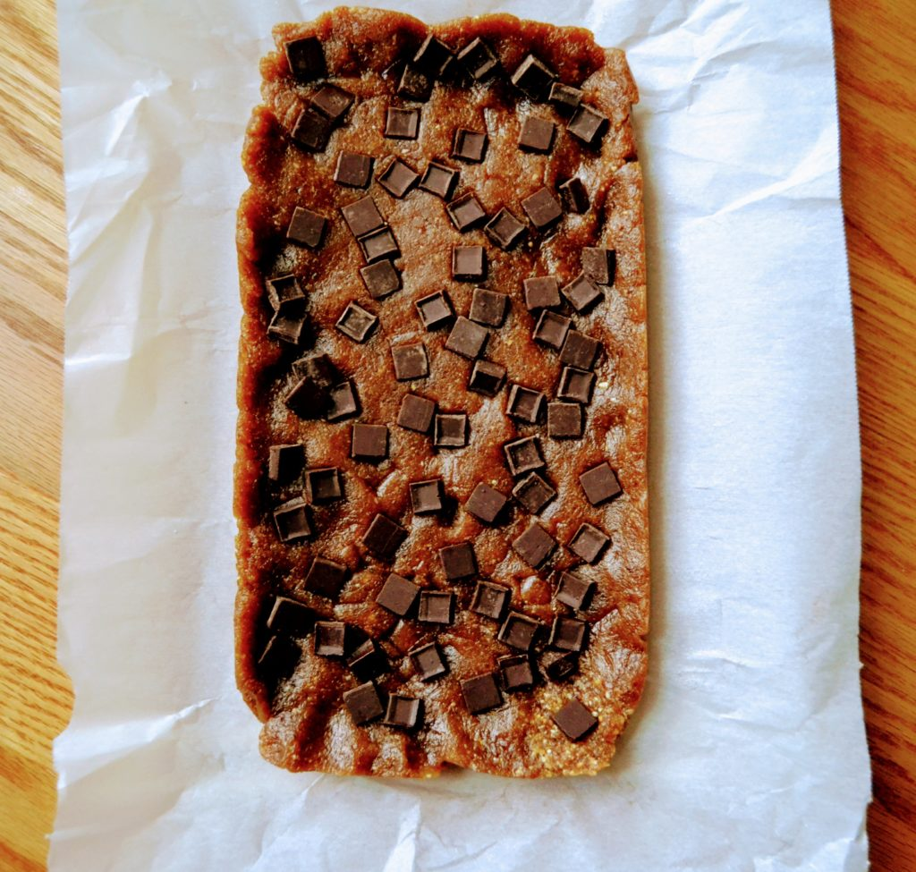 Peanut butter chocolate chip copycat Larabars are really easy to make at home. These no bake treats only require three ingredients to make. They're vegan, gluten free and a healthy snack that is less expensive than buying Larabars from the store. #healthysnacks #healthybars #copycat