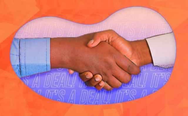 Image of two people shaking hands with